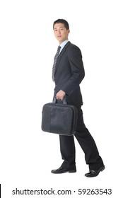 Walking pose of businessman isolated on white background.