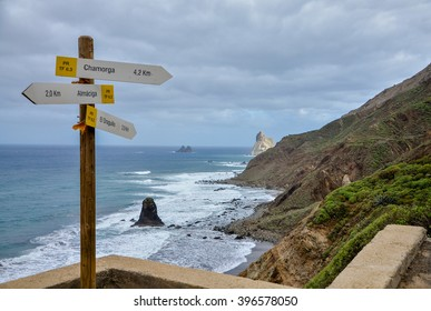 walking routes signpost with Roques de Anaga in the background Benijo, Anaga Parque Rural, Tenerife, Canary Islands, Spain
