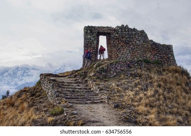 Walking up to a ruin in the Andes.