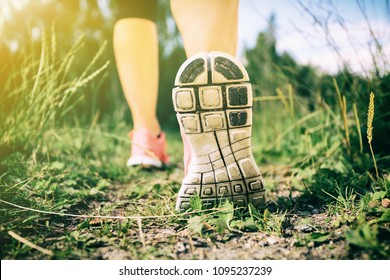 Walking or running exercise, legs on footpath in forest, achievement fitness adventure and exercising in spring or summer nature