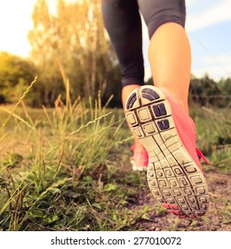 Walking or running exercise, legs on footpath in forest, motivation inspiration concept outdoors, achievement fitness adventure and exercising in spring or summer nature