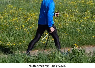 walking senior man on sunny springtime day exercising for health