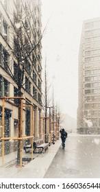 Walking in Snowfall with Urban Setting