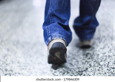 walking and step forward with outdoor shoes and jeans