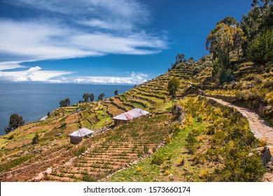 Walking stone path in village on Taquile island at Titicaca lake, Peru. South America.