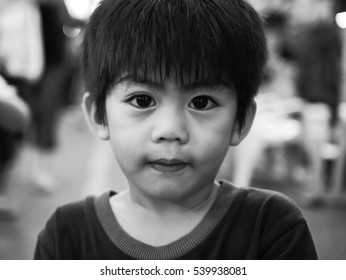 Walking street, Lampang,Thailand: October 15 2016:  Black and white portrait of unidentified big eye boy at walking street, Lampang,Thailand on October 15, 2016