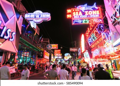 Walking Street in Pattaya at night PATTAYA, THAILAND - DECEMBER 23, 2016: The street is a tourist attraction, The Walking Street area includes seafood restaurants, beer bars, nightclubs and hotels.