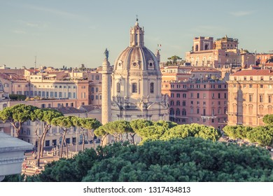 Walking streets of Rome. Church of the Most Holy Name of Mary at the Trajan Forum and the Trajan's Column in Rome, Italy. Chiesa del Santissimo Nome di Maria al Foro Traiano. Colonna Traiana