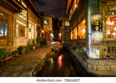 Walking the streets of the UNESCO World Heritage Site in Lijiang Old Town, Yunnan Province, China - 10 September 2015
