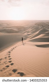 Walking in the Sunset in Huacachina, a desert oasis and tiny village just west of the city of Ica in southwestern Peru
