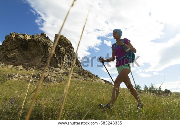 walking trails in the mountains. young girl walking among the rocks.