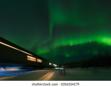 Walking train and aurora borealis over the tundra