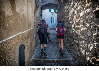 Walking in a village of Lake Como during a visit