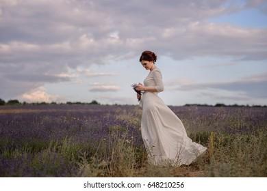 Walking woman in the field of lavender