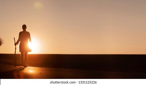 Walking woman at Sunset