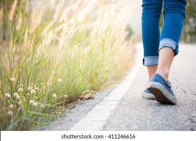 Walking women jeans and sneaker shoes