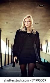 Walking young blonde woman