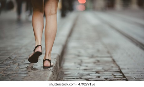 Walking young girl on the street in the summer