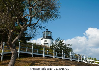 Walkway allows tourists to climb up steep hill to Owls Head lighthouse in Maine, with its authentic fresnel lens in the tower.