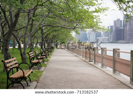 walkway along park benches grass field stock photo edit now