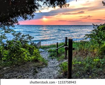Walkway to beach at sunset on Lake Michigan near Sleeping Bear Dunes National Lakeshore.