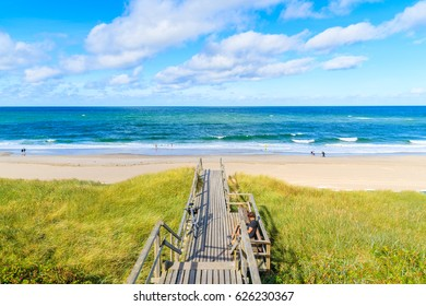 Walkway to beautiful beach in Westerland village on Sylt island, North Sea, Germany