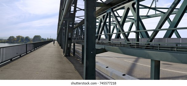 walkway and bike lane on a  steel framework screwed with bolts of a road bridge across the river Danube at Tulln, Austria
