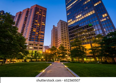 Walkway and buildings at Center Plaza at night, in downtown Baltimore, Maryland.