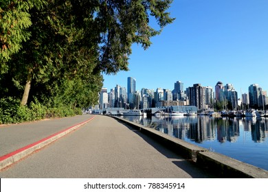 Walkway by Vancouver waterfront in Stanley park, British Columbia