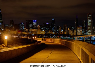 Walkway with Chicago night skyline in the background, Chicago, Illinois, USA