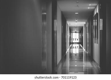 Walkway in condominium, apartment with warm lighting