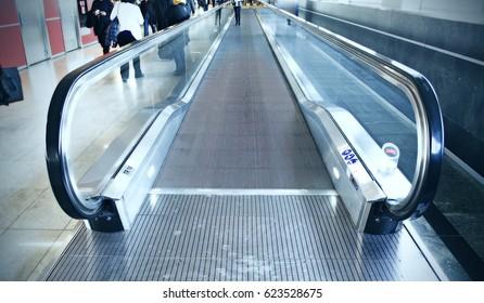 walkway escalator in airport terminal