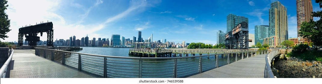 Walkway at Gantry Plaza State Park and Manhattan in panorama view