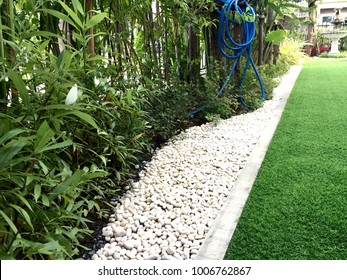 Walkway in the garden by artificial grass , architecture design of grass field around home, artificial grass, home outdoor decoration concept