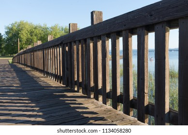A walkway leads to a park by a large lake in Eugene, Oregon
