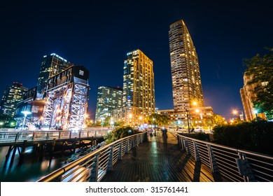 Walkway and Long Island City at night, seen from Gantry Plaza State Park, Queens, New York.