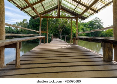Walkway made of wood with roofs for crossing the river.
