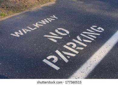 walkway no parking painted on asphalt