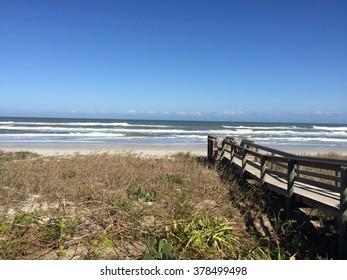 Walkway to ocean over sand dune