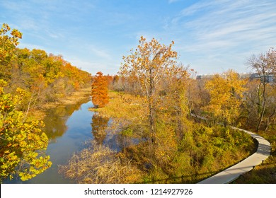 A walkway on Theodore Roosevelt Island in autumn in Washington DC, USA. Swamp Trail runs in parallel to Potomac River that separates the island from Georgetown waterfront.