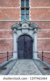 Walkway to ornate gate of a medieval brick castle, Europe