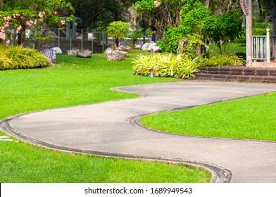 Walkway pathway curve in public garden, Bangkok Thailand.