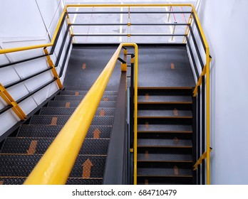 The walkway shows safe climbing using the yellow arrows to indicate walking direction, Fire escape stairs, Steel stairs and rails.