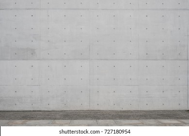 walkway / sidewalk and exposed concrete wall background -