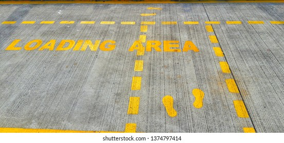 Walkway signs and footsteps are painted yellow on the floor and laid down yellow lines in the factory and delivery loading area.