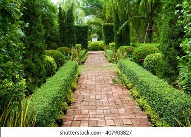 Elegant Walkway Through English Country Garden
