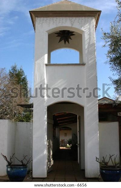 walkway through  white building