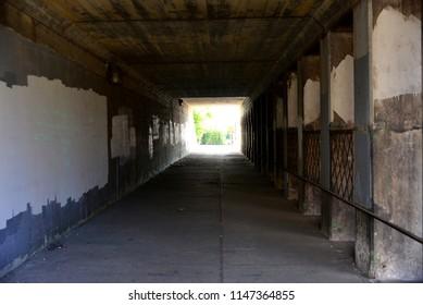 Walkway under an old railroad bridge in Milwaukee, Wisconsin.  Image take on public property.