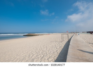 Walkway to walk along the beach of Costa Nova, Aveiro district. Portugal