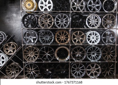 wall of alloy wheels in the store. Auto repair shop background. Auto Wheel Service